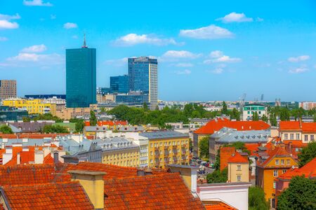Warsaw, Poland modern skyscrapers and old colorful houses in Old Town of polish capital skyline aerial view