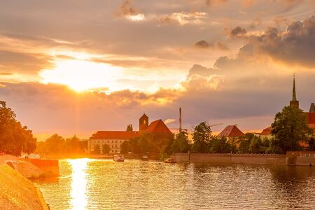 Wroclaw, Poland sunset panoramic view with Ostrow Tumski island, Odra or Oder river and cathedral towers Banco de Imagens
