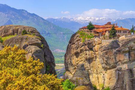 Meteora, Greece Agios Stefanos St Stefan Monastery on cliff mountain rock and snow peaks