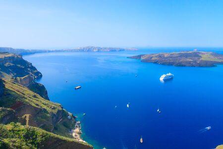 Santorini, Greece caldera, volcano island and sea panorama with cruise ships