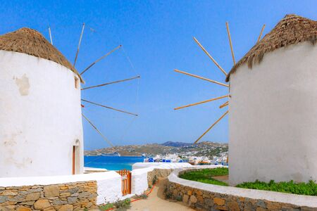 Mykonos, Greece, greek iconic windmills and little venice panorama in famous island
