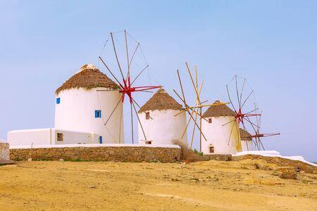 Greek iconic windmills panoramic background in Mykonos, Greece, famous island in Cyclades 版權商用圖片