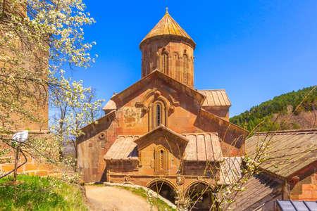 Sapara orthodox monastery church and spring flower tree blossom, Akhaltsikhe, Georgia