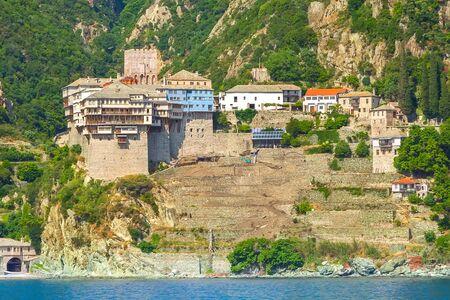 Close up Agia Grigoriou Orthodox monastery at Mount Athos, Agion Oros, Holy Mountain, Halkidiki, Greece. View from the sea