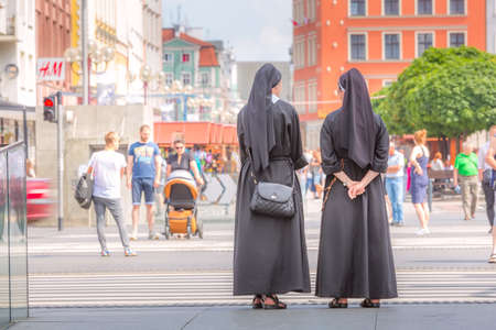 Wroclaw, Poland - June 21, 2019: Two nuns in downtown of famous Polish city Vroclav