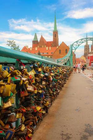 Wroclaw, Poland - June 21, 2019: Symbolic love padlocks on the Tumski Bridge