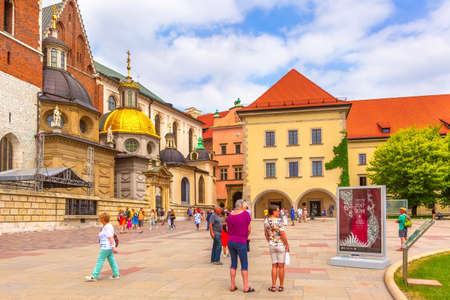 Krakow, Poland -June 18, 2019: Wawel Royal Castle colorful view and people in Cracow