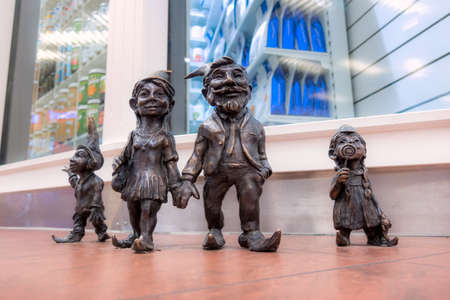 Wroclaw, Poland - June 21, 2019: Dwarfs gnome family small figurines in the shop