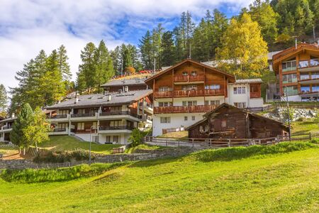 Zermatt, alpine village, Switzerland, Swiss Alps colorful autumn panorama, houses and trees Standard-Bild