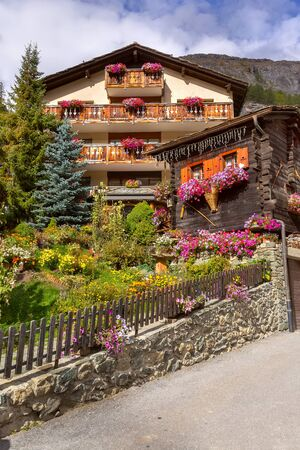 Zermatt, alpine village, Switzerland, Swiss Alps, traditional wooden houses decorated with flowers