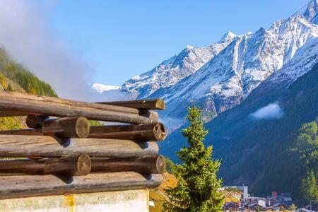 Swiss Alps in Switzerland, wooden balcony and snow peaks in Zermatt