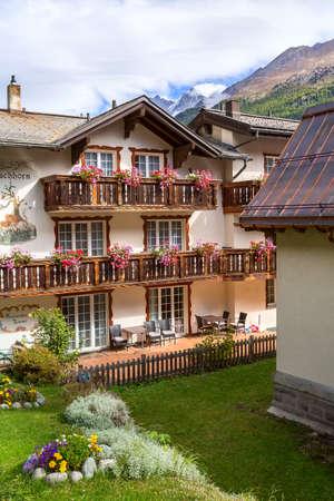 Zermatt, Switzerland - October 7, 2019: House decorated with flowers in alpine village, Swiss Alps Editorial