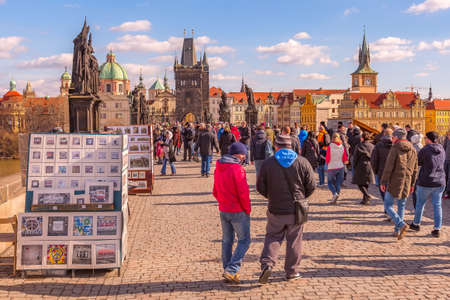 Prague, Czech Republic - February 25, 2017: People at Charles Bridge and historic buildings panorama