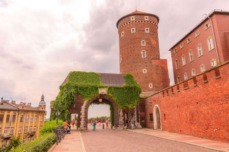 Krakow, Poland - June 18, 2019: Tower and arch, Wawel Royal Castle in Cracow