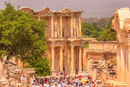 Kusadasi, Turkey - April 28, 2019: People visiting Celsus Library and old ruins of Ephesus or Efes famous site Editorial