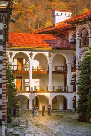 Rila, Bulgaria - October 27, 2017: Rila monastery view with autumn mountain trees at background Editorial