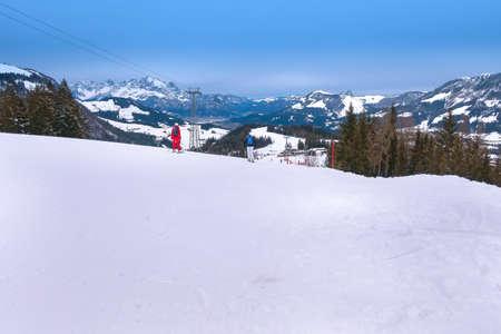 Saalbach-Hinterglemm, Austria - March 1, 2020: People skiing at ski slope of austrain winter resort Editorial