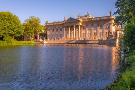 Poland, Warsaw. Lazienki palace with reflection in pond water in the park, Lazienki Krolewskie