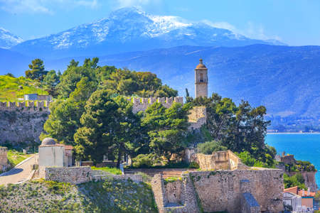 Nafplio or Nafplion, Greece, Peloponnese church on the hill, old town aerial panorama with snow mountain peaks Stockfoto