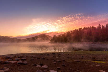 Beautiful morning with rising sun on lake, Bulgaria, Rhodopes, Shiroka polyana,