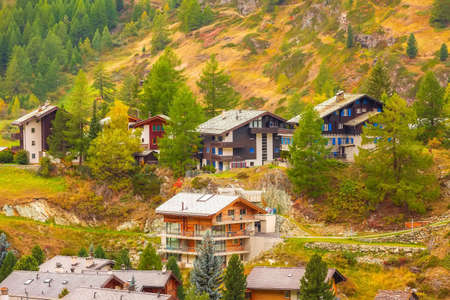 Zermatt, Switzerland town aerial view in famous swiss ski resort, traditional wooden chalet Фото со стока