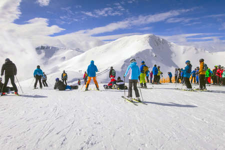 Saalbach, Austria - March 6, 2020: Skiers and snowboarders ready for skiing from top ski lift station