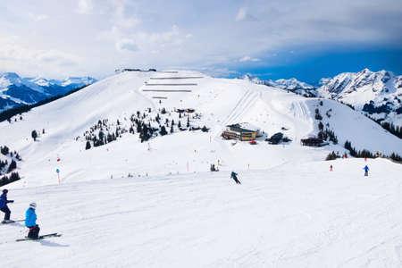 Saalbach, Austria - March 1, 2020: People skiing at ski slope of austrain winter resort
