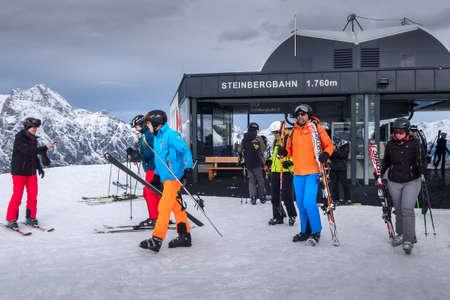 Saalbach, Austria - March 2, 2020: Skiers going skiing from ski lift station Steinbergbahn Leogang Редакционное