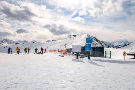 Saalbach, Austria - March 2, 2020: People skiing at ski slope of austrain winter resort