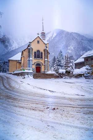 Chamonix Mont-Blanc, France landmark, Saint Michel Church and snow mountains in winter Stock Photo
