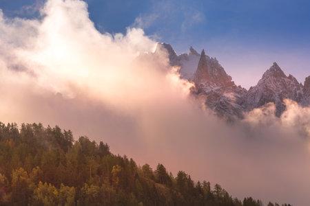 Fantastic evening snow mountains landscape background. Colorful pink and blue clouds overcast sky. French Alps, Chamonix Mont-Blanc, France Reklamní fotografie