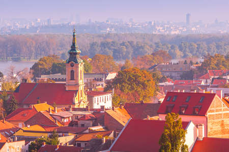 Belgrade, Serbia panoramic aerial city view of Zemun houses with church tower at sunset