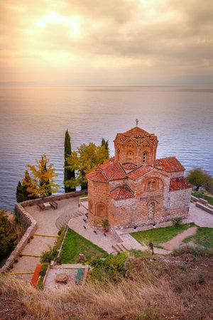 Ohrid, North Macedonia, sunset over lake and Saint John at Kaneo church Standard-Bild