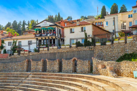 Ohrid, North Macedonia - October 2, 2014: Old antique amphitheater and houses