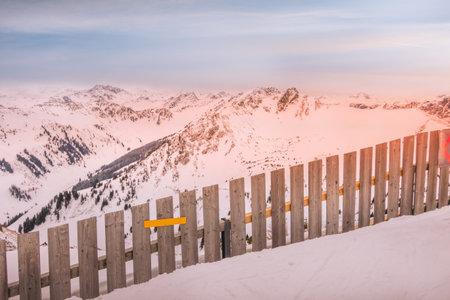 Austria, Saalbach panorama of snow mountains landscape and colorful sunrise Standard-Bild
