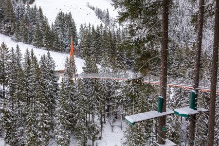 Golden Gate Baumzipfelweg metal bridge near Saalbach, Austria, Europe, snow mountains and forest panorama
