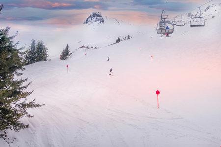 Ski chair lift and slope view in austrian resort Saalbach Hinterglemm, Austria Standard-Bild