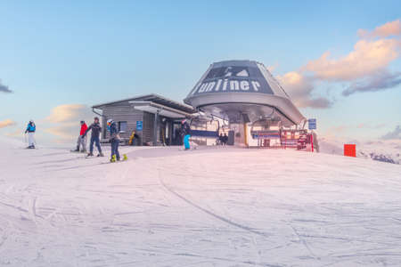 Saalbach, Austria - March, 5, 2020: Skiers and snowboarders ready for skiing from top ski lift station Editorial