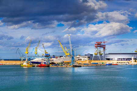 Ancona, Italy, the port with cranes and ships loaded Standard-Bild