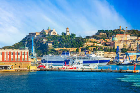 Ancona, Italy, the port with cranes and ships loaded and old fortress on the hill Standard-Bild