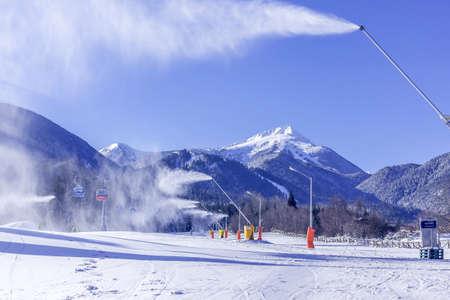 Bansko, Bulgaria - January 28, 2021: Bulgarian winter ski resort panorama with gondola lift cabins, Pirin mountain peaks view and slope
