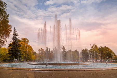 Budapest, Hungary - November 6, 2014: Beautiful view of Margaret Island Fountain and people are sitting near it
