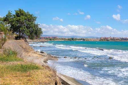 Aheloy, Bulgaria coastline, turquoise sea waves beach panorama background and Ravda town on the Black Sea