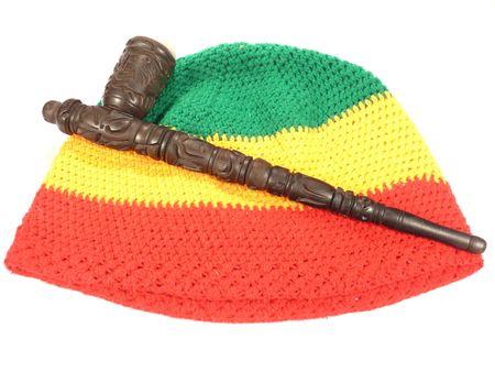 rasta hat: Pipe and rasta cap Stock Photo