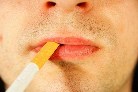 Cigarette in mouth photo