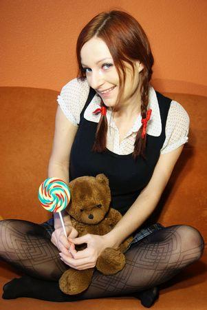 school uniform girl:   Red head girl and teddy bear