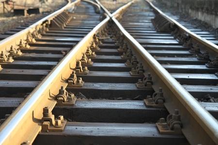 rail cross: Cross on rail track Stock Photo