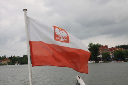 Polish flag with eagle on the boat in Mikolajki city