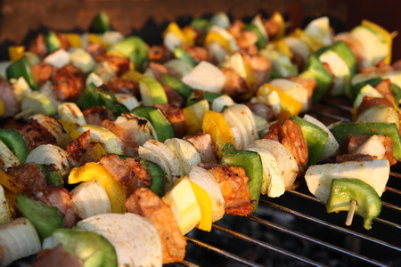 barbecuing: barbecuing skewers Stock Photo