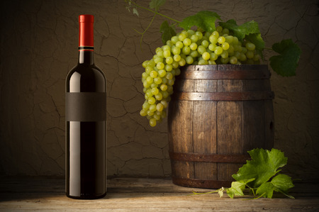 Wine glass on vineyard background
